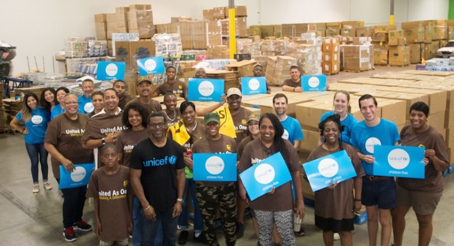 Volunteers help prepare School-in-a-Box kits for children and teachers displaced by Hurricane Harvey.