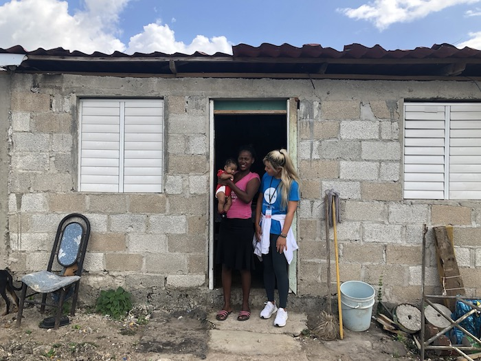 Danielle Kang visits a young mother and her baby during a field visit to the Dominican Republic with UNICEF Next Generation.