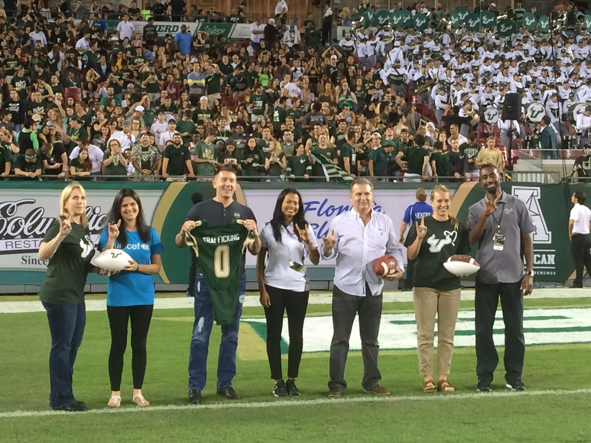 The U.S. Fund for UNICEF, the Florida Dream Center, and the NCAS are honored on the Football field during halftime.
