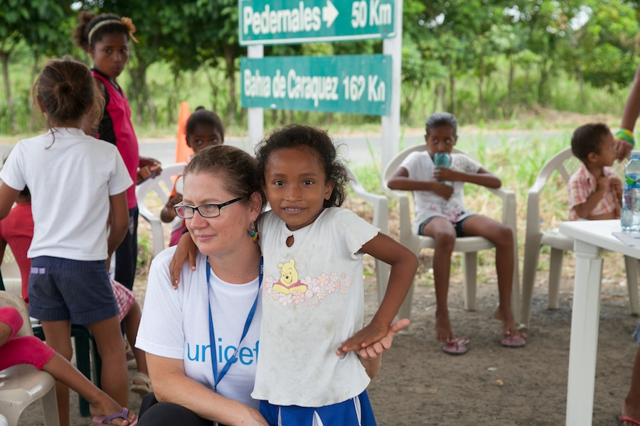 "Belen Carillo, UNICEF Ecuador child protection specialst, with Kimberly,6,  at the ""Y"" encampment just outside of San Jose de Chamanga, Ecuador."