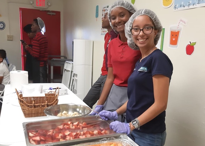 Kids at the Boys & Girls Clubs of Puerto Rico take turns helping out in the kitchen and serving food to their peers.