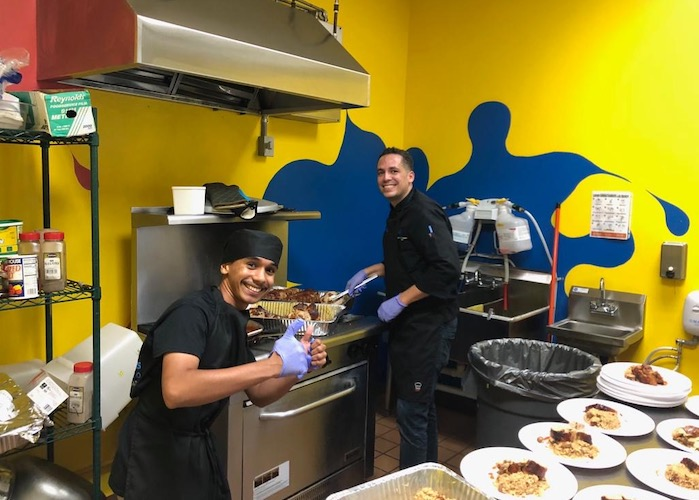 Seventeen-year-old Bryan (left) learned to love cooking after working with Chef David Ortiz in the kitchen of the Boys & Girls Clubs of Puerto Rico.