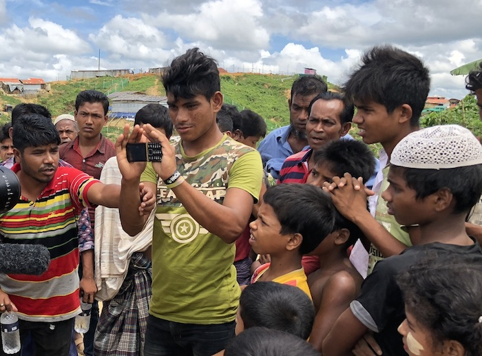 Rohingya refugees in Cox's Bazaar, Bangladesh, get a look at a new blockchain-enabled messaging service developed by the Banglesh-based startup W3 Engineers, a UNICEF Innovation Fund portfolio investment selected for follow-on funding from ETC Labs.