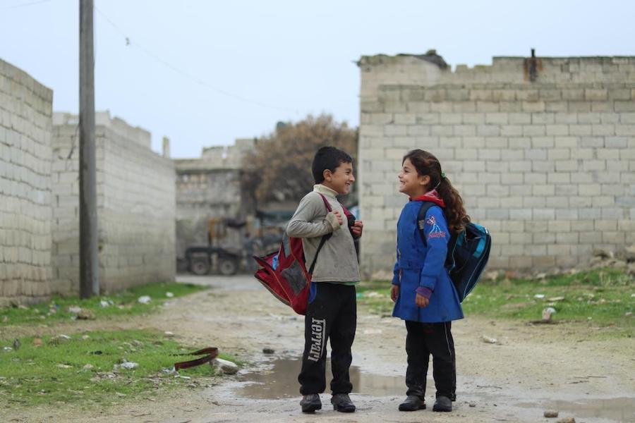 "Zahra, 7, walks to school with her friend in Karm Al- Nezha neighborhood of east Aleppo. ""I choose the long way to school because it's less muddy,"" she says. Photo: UNICEF/ Syria 2018/ Khudr Al- Issa"