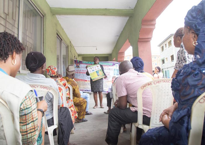 A UNICEF-supported health worker shares best practices for fighting the spread of COVID-19 with a group in Lagos, Nigeria in March 2020.