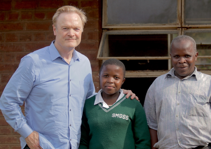 MSNBC's Lawrence O'Donnell (left) met student Joyce Chisale (center) during a 2016 visit to Malawi in support of the UNICEF/K.I.N.D. Fund.