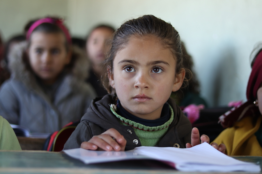 Nour, 7, attends a UNICEF-supported self-learning session in Qaramel village in northern rural Aleppo, Syria.