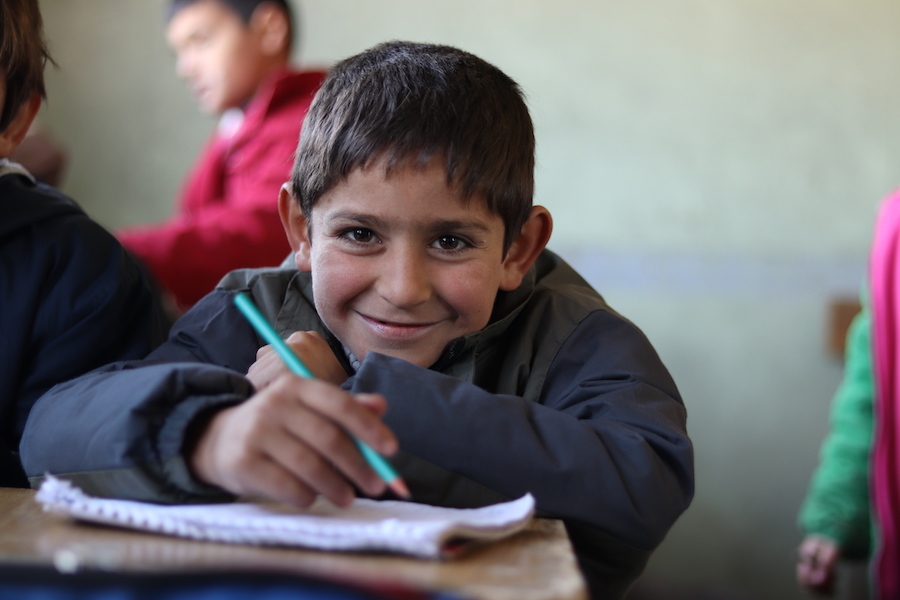 Ali, 7, attends a UNICEF-supported self-learning session in Qaramel village in northern rural Aleppo, Syria.