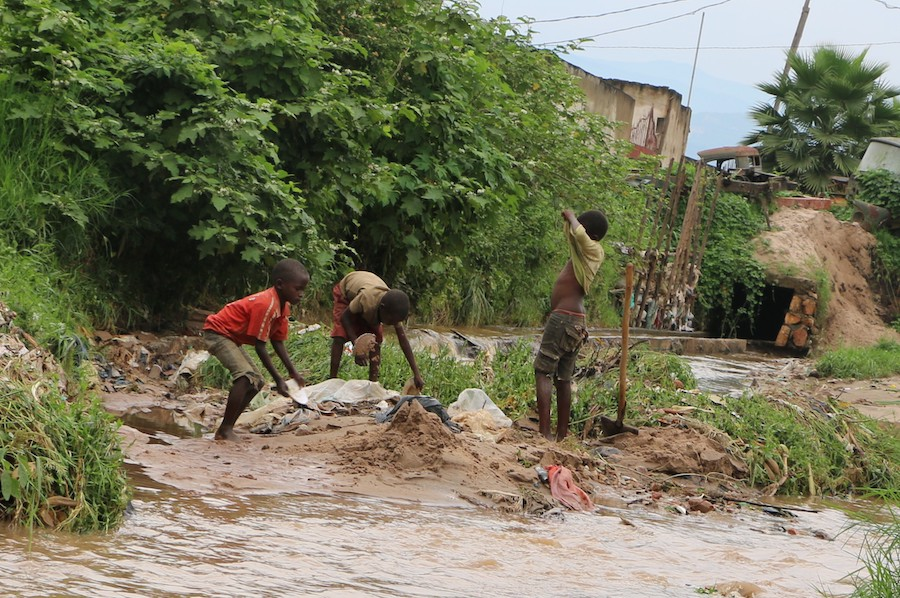 On January 29, 2020, boys play in the muddy ruins of their neighborhood after massive flooding in Bujumbura, Burundi.