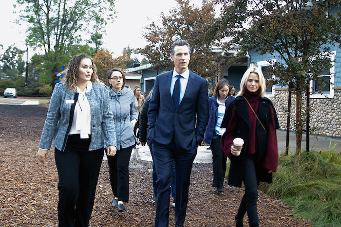 Kate Clark, Senior Director of Immigration Services at JFS leads a shelter tour for Governor-Elect Gavin Newsom and staff in November 2018.