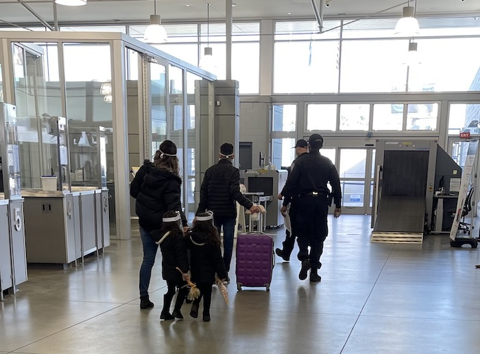 A family previously enrolled in MPP approaches the border, where they will be allowed to continue pursuing their asylum case while in the U.S..