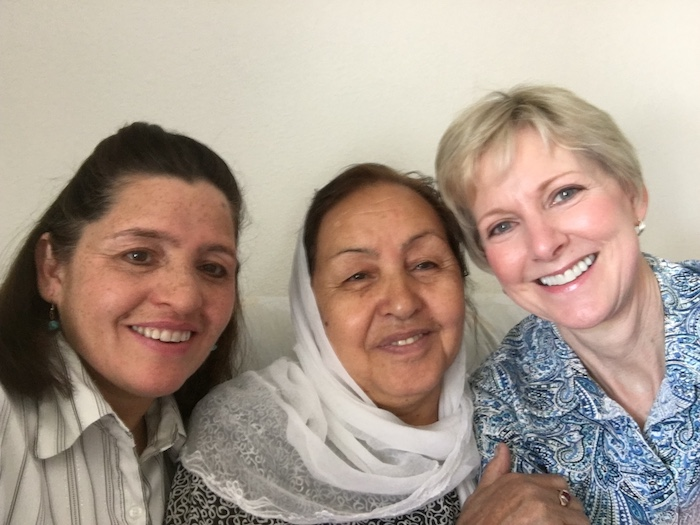 Asifa and her daughter Nadira, refugees from Afghanistan, with their friend and ESL teacher Sister Jean B. Bingham of LDS Charities.