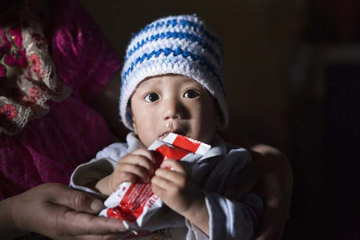 A child in Guatemala is fed ready-to-use therapeutic food (RUTF), provided by UNICEF, to help stave off malnutrition