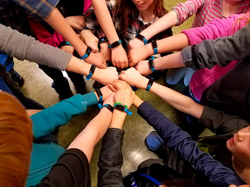 Kasey Bird's third-grade class shows off their UNICEF Kid Power Bands.