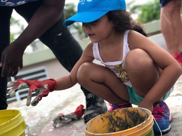 Kayli, 6, helped student volunteers do post-hurricane roof repairs in Guaynabo, Puerto Rico.
