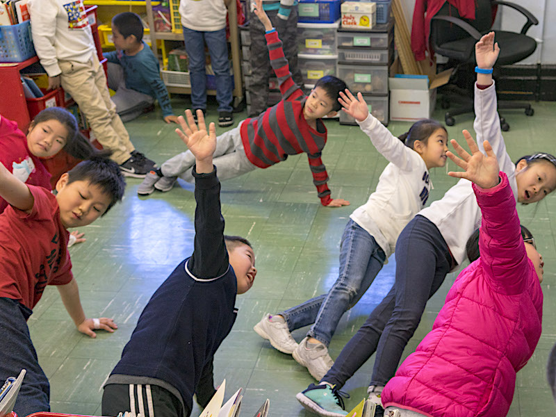 "Students in Ms. Law's class at P.S. 42 take a ""brain break"" by doing a Kid Power Up."
