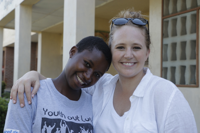 K.I.N.D. scholarship recipient Rehema, left, with UNICEF USA's Lauren Davitt in Namwera, Malawi.