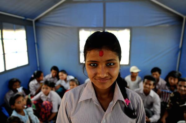 Laxmi Giri, 16, inside the makeshift tent school of Shree Balephi Secondary School.