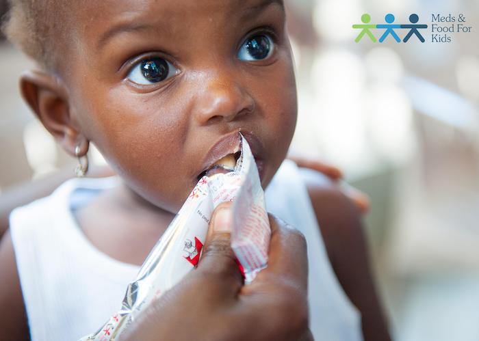 "Malnourished children in Haiti are treated with a nutrient-rich peanut paste called ""Medika Mamba."""