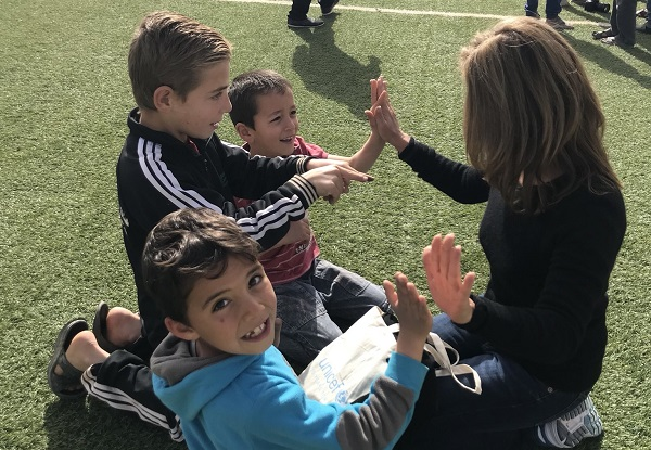 On a field visit to Za'atari refugee camp in Jordan, Marimo Berk plays with three young boys at a UNICEF-supported Child-Friendly Space.