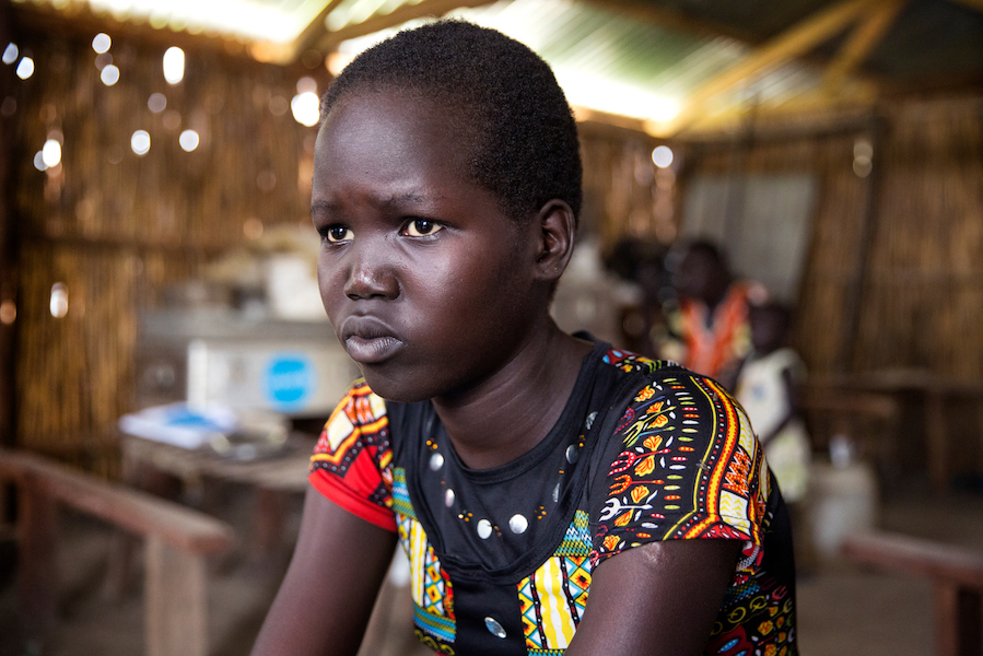 Mary, 15, sits in a classroom at the Machakos Primary School, Bentiu, South Sudan, July 2017.