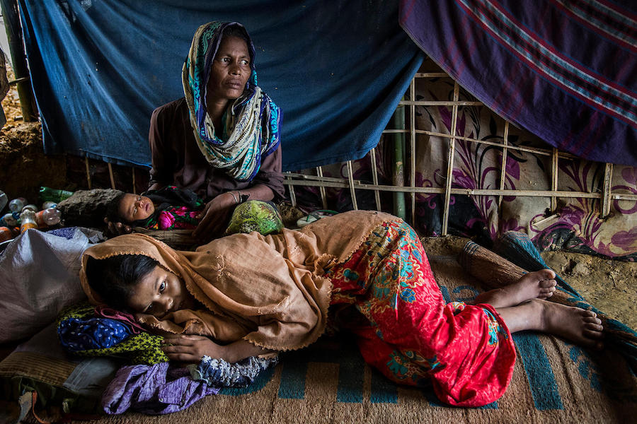 Exhausted, 18-year-old Hazera is reunited with her newborn and her mother after giving birth in the UNICEF-supported birthing center in the Kutupalong camp for Rohingya refugees in Cox's Bazar, Bangladesh.