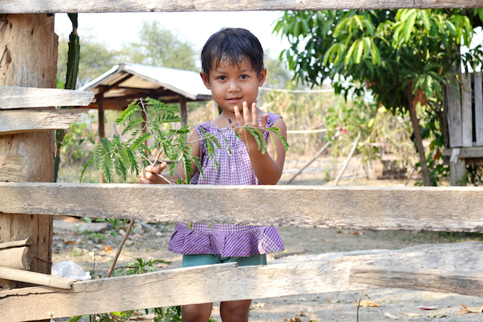 Four-year-old Treza proudly shows her left little finger, marked after she received a complete dose of polio vaccine in Baw La Khe, Myanmar.