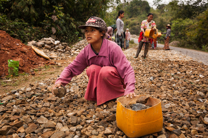 Rai, 13, works for low wages building and repairing roads in Myanmar. The country faces humanitarian crises resulting from conflict in Rakhine, Kachin and Shan states. In addition, other parts of the country face natural disasters, health emergencies and