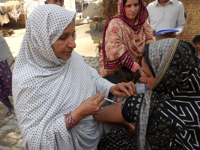UNICEF-trained community health worker Jameela vaccinates women against tetanus in an isolated village in Pakistan.