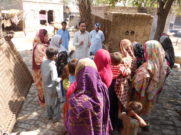 District Vaccinator Supervison Waseem Siyal briefs a rural community in Pakistan on the importance of vaccinations.