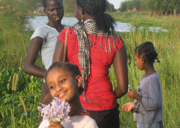 On a return trip to South Sudan in 2009, Rebecca Deng picked flowers with children in the village of Atar, about an hour away by boat from the city of Malakal.