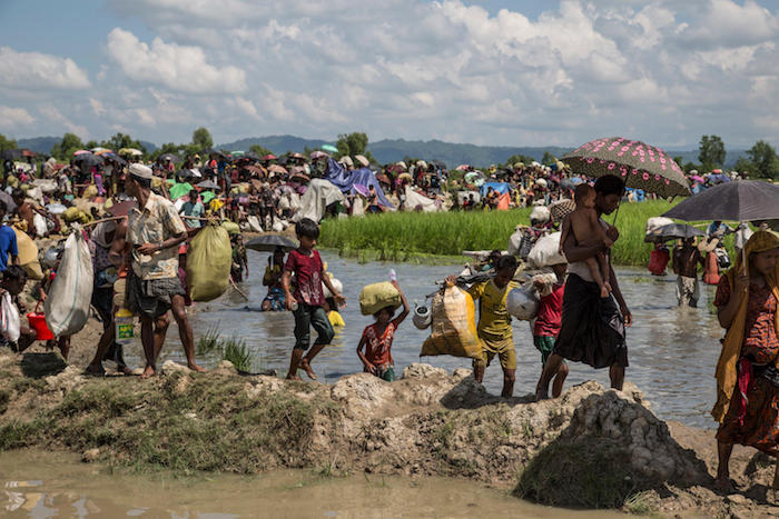 Thousands of Rohingya refugees fleeing Myanmar are stuck on a pedestrian road in the midst of paddy fields two kilometers from the Bangladesh border on October 16, 2017.