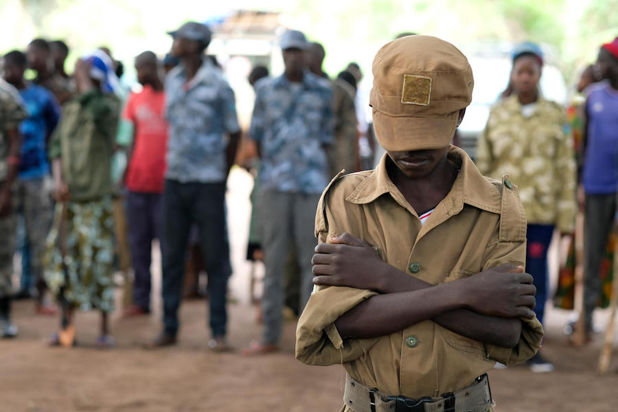 Jackson, 13, stands outside a ceremony to release children from the ranks of armed groups and start a process of reintegration in Yambio, South Sudan.