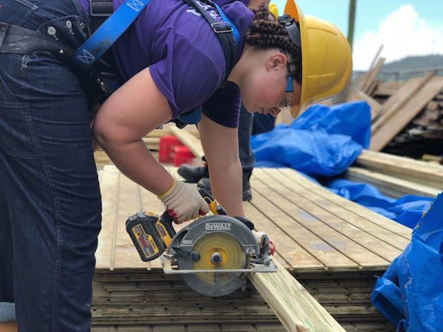 College students from New York state helped rebuild roofs on hurricane-damaged homes in Puerto Rico as part of a UNICEF USA-supported volunteer program.