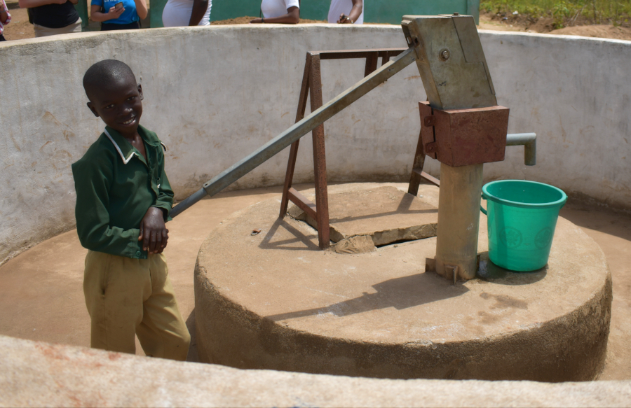 A young boy named Coker draws water from a well. UNICEF Sierra Leone.