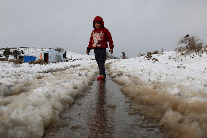 Laith, 6, lives in a camp for internally displaced people in rural Quneitra, Syrian Arab Republic, where heavy snow falls in winter.