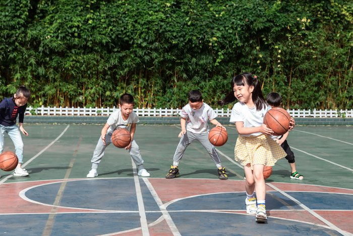 Kindergarteners play basketball in Chongqing, China. After implementing a series of safety measures following the outbreak of COVID-19, schools reopened and children returned to learning and playing with classmates. Shop UNICEF Inspired Gifts