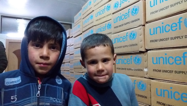 "Ahsraf*, 11, and his friend Ali*, 9, in Madaya's only health center. ""I play at home because school is closed,"" Ashraf says."