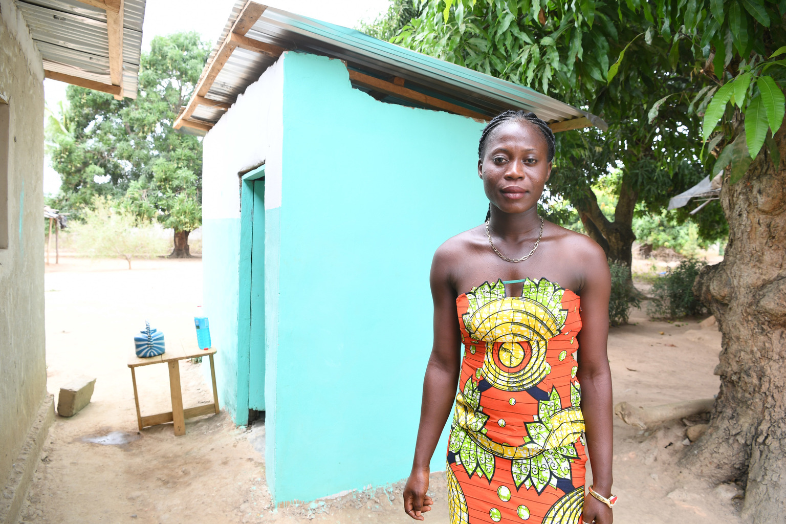 Emmanuelle Zroh of Guehiebly, Côte d'Ivoire is happy to let her neighbors use her new toilet.