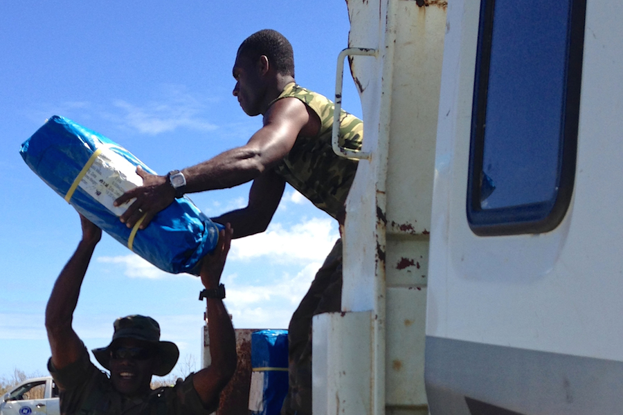 Soldiers load UNICEF relief supplies for urgent distribution to communities  on Tanna Island, Vanuatu.