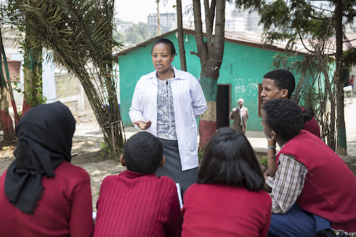 Netsanet Abebe, Vice Director of a junior secondary school in Addis Ababa, Ethiopia, meets with members of the school's gender club to discuss ways to combat violence against girls.