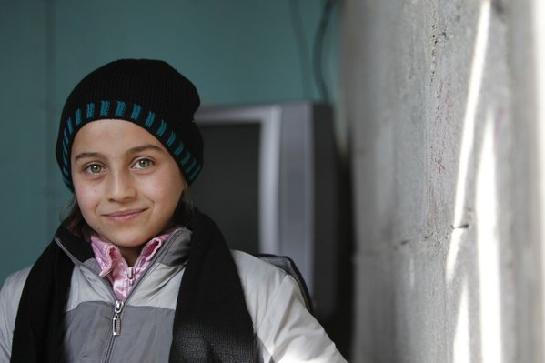 Teba and her family have been displaced six times in Syria over the last three years. They live in a poorly insulated building outside Damascus so the clothes UNICEF gave her will get her through the winter