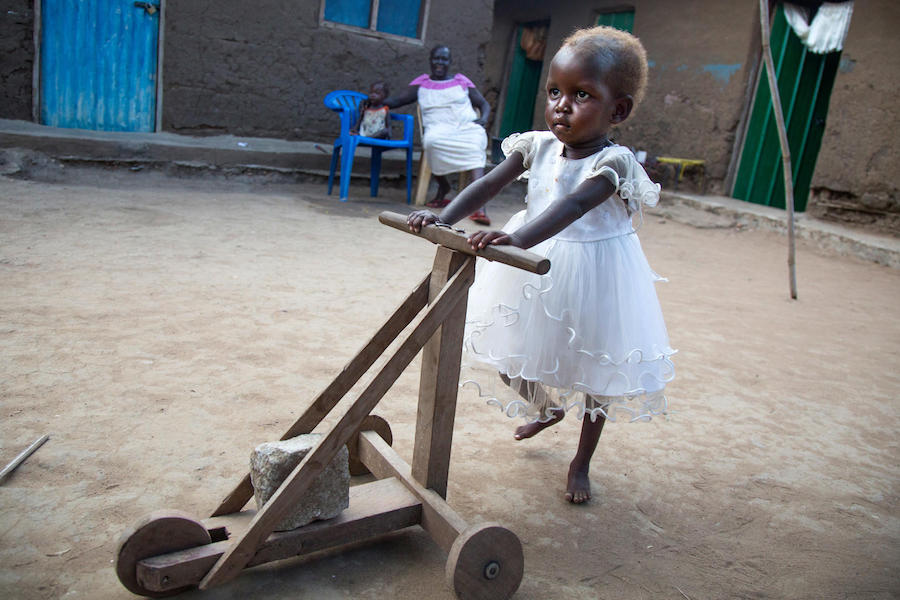 Treated for severe acute malnutrition at a UNICEF-supported health center in Juba, South Sudan, two-year-old Maria pushes a handmade cart in November 2017.