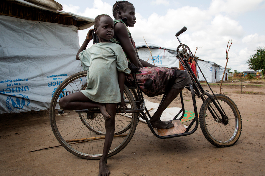 Nyahok, who is physically disabled and relies on a tricycle for mobility, lives in the Kochethey internally displaced persons (IDP) camp, Bentiu, South Sudan, July 2017.