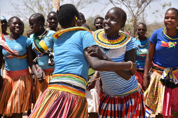 Girls and women from Ausikioyon village in Uganda's Amudat District celebrate after their village made a public declaration against female genital mutilation in 2017.