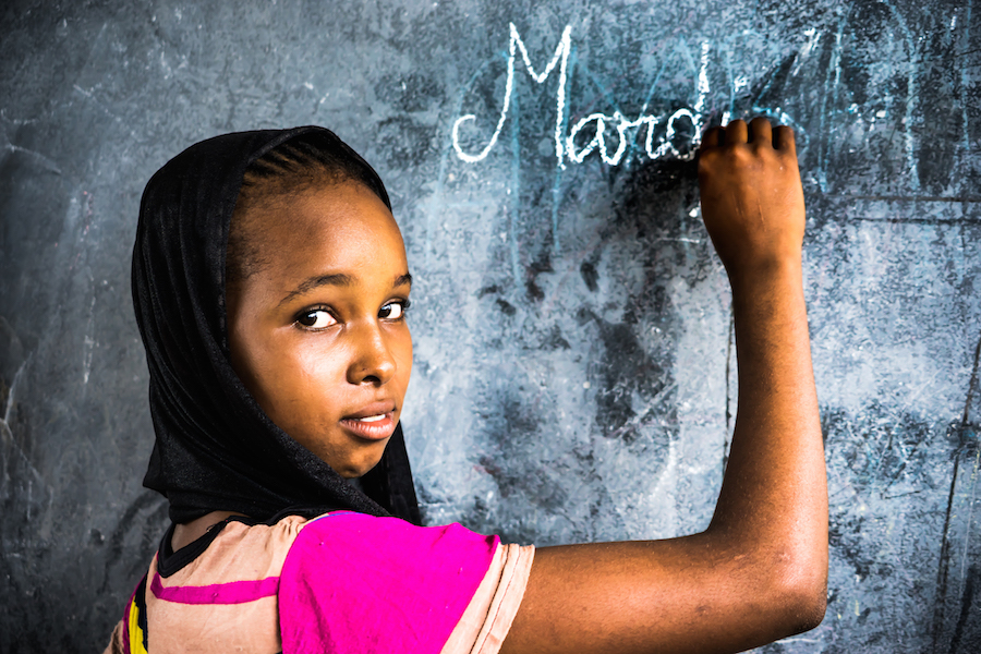 """Thanks to UNICEF supplied sanitary napkins, 15-year-old Hawa, a student at a school near the refugee camp where she lives, has the confidence to leave home during her period. """"I love understanding things, that's why I love school."""""""