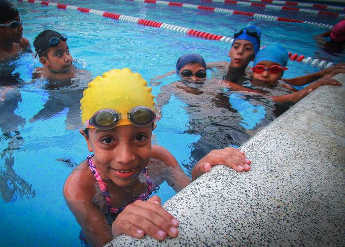 On August 9, 2017, Natividad, 7, takes swimming lessons at her local recreation center, part of a UNICEF-supported program to help children avoid the dangerous streets in her neighborhood in San Salvador, El Salvador.