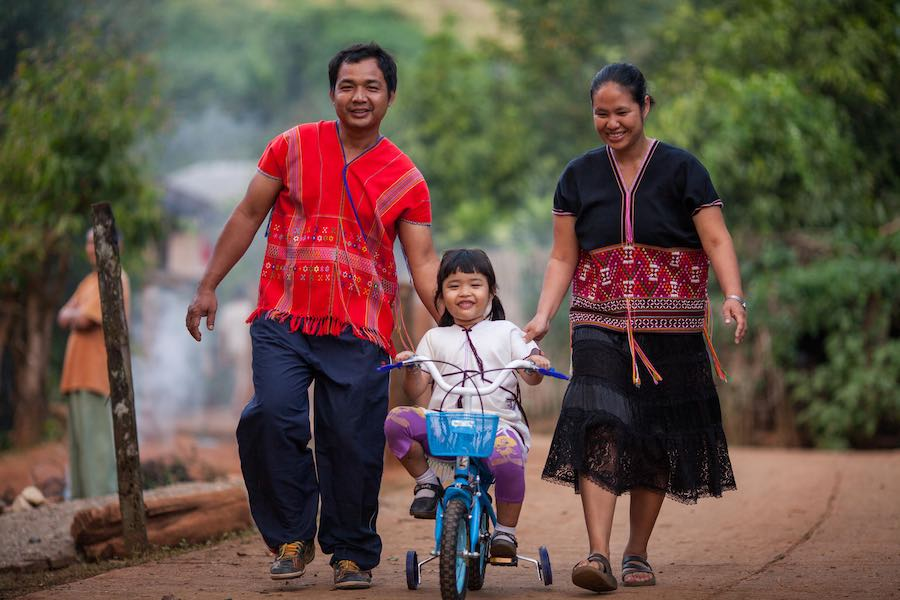 Preschooler, Chommeelap enjoys some family time with her parents at her school in Thailand's Mae Hong Son northern province. Her mom and dad know the secret to raising a happy, healthy child: nutritious food, free time to play and the love and devotion of