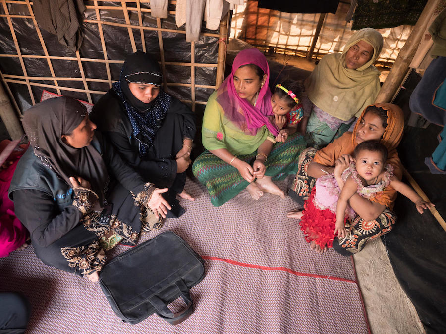 Johora, far left, is a UNICEF-trained Model Mother who visits Rohingya refugee families in Kutapalong Refugee Camp in Cox's Bazar, Bangladesh.