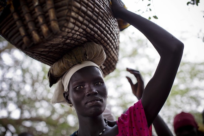 Woman in South Sudan waiting to receive a tetanus vaccine